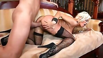 Blonde pornstar Nikita Von James in black stockings and high heels