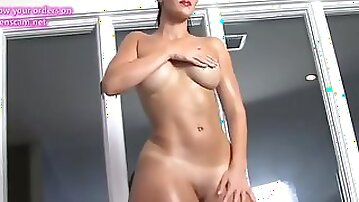 Oiled up lady teases just for you