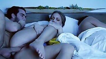 Stepson bangs his smoking hot stepmom next to a sleeping dad