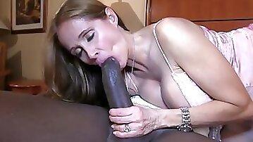 Adorable blonde MILF deepthroating a big black cock