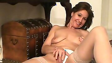 Sexy sparkling dress on a gorgeous mature model