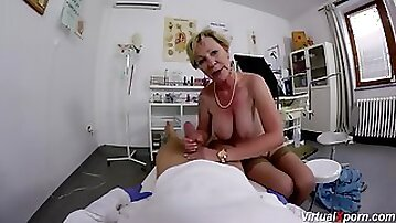 Busty mature blonde GILF in stockings rides the gynecologists knob in POV