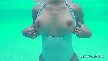 Exhibitionist Lada - Hotel pool - Big tits flashing outdoors