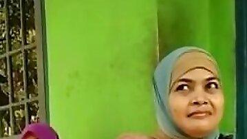 Beautiful Indonesian mom in hijab