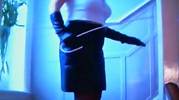 My mature voluptuous wife in her leather skirt and gloves