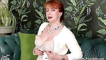 Redhead Milf masturbates in high end retro chic lingerie seamed nylons and designer heels