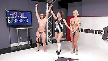 Brunette babe humiliates busty blonde after winning a wrestling match