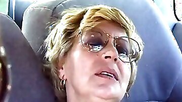 Mature Pauline fingers her old pussy in a car and gets fucked