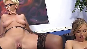 Mommy shows young daughter how to ride a cock