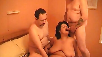 Ugly super fat brunette mature slut tries riding and sucking cocks (MMF)