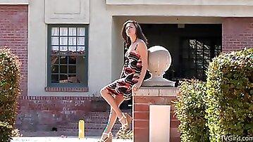 Horny teen sits hard on a fire hydrant