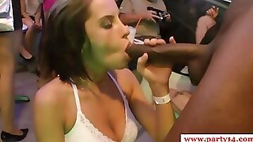 Drunk females give blowjobs to athletic strippers at night club party