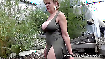 Mature doll Sonia takes off entirely nude outdoors