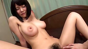 Enchanting Asian lady with a hairy pussy rides the stiff dick