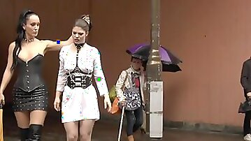Bosomy slave bootie caned in the rain
