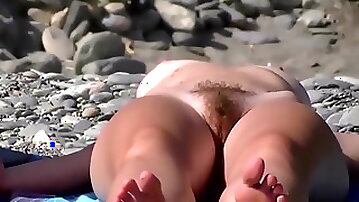 Girl with Hairy Pussy on the Beach Close-up