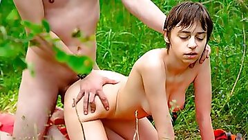 Short-haired girl with huge boobs is having sex in the forest