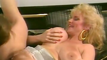 Beautiful mature blonde babe on the couch licked and screwed