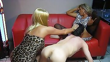 Skinny male slave and two mistresses