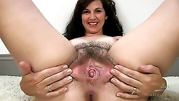 Mature bush looks dark and sexy in close up