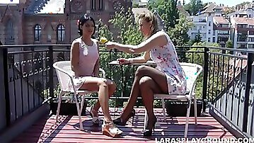 Milf and a sexy girl in sundresses lick pussy erotically