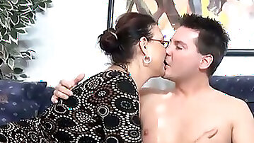 Plump secretary with droopy boobs blows stiff dick of her boss after work