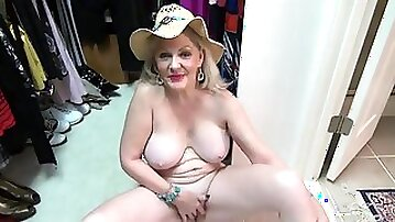 Mature cutie on her closet floor has a shaved pussy