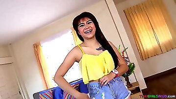 Bouncy butt Thai teenager pokes white stud