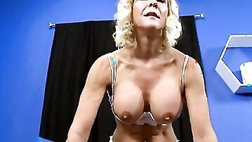 Mature lady stares at the camera while riding that cock reverse cowgirl