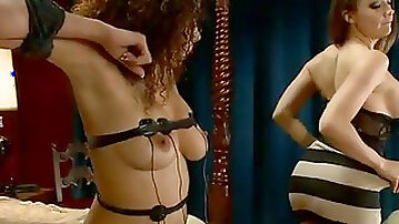 Busty ebony chick is belted and punished by horny electro mistress
