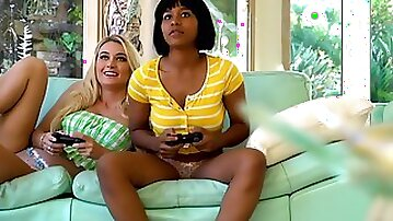 Aroused teens stop their gaming for a bit of licking