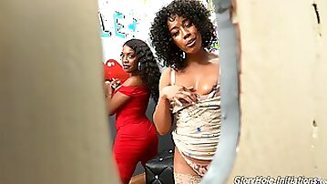 Sexy black babes Cecilia Lion and Daya Knight enjoy gloryhole action
