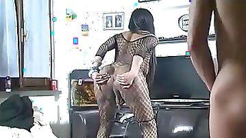 Ugly ebony tranny in fishnet bodysuit rides a meat bazooka