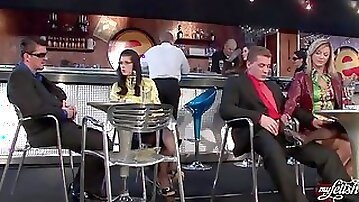 Foot and stroking foreplay in the bar