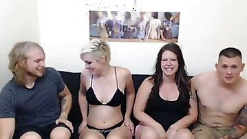 Two lusty bitches sucking hard dicks on dirty swingers party