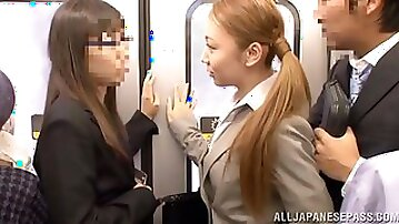 Blonde Japanese girl sucks a cock and gives handjob in a metro train