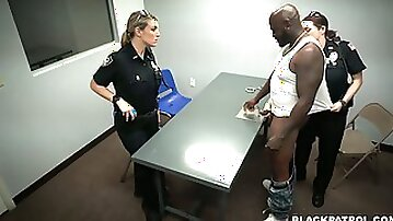 Two curvaceous and crooked white police women use black criminal for unlawful threesome