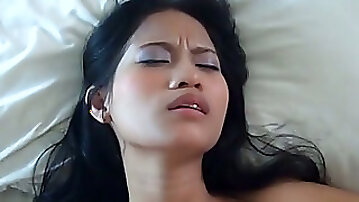 Lovely Filipina girl is penetrated in a missionary position