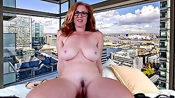 Redhead mum in eyeglasses with natural big tits plays with dildo