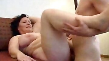 Man is happy to polish my mature pussy on the sofa