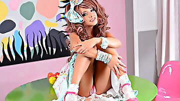 Cute teenager dressed as a doll shows her nice ass